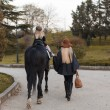 Beautiful family with horse — ストック写真