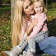 Beautiful mother with little cute daughter — Stock Photo