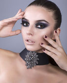 Beautiful model with smokey eyes make up — Stock Photo