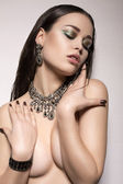 Sexy girl with dark hair with jewellery — Stock Photo