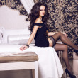 Beautiful woman with black hair in luxury interior — Stock Photo