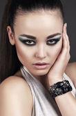 Beautiful woman with smokey eyes make up — Stock Photo