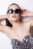 Sexy woman in luxurious corset and sunglasses — Stock Photo