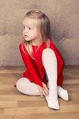 Pretty little girl in a red short dress — Stock Photo