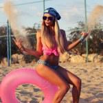 Sexy blond woman in bikini and aviator sunglasses — Stock Photo #42260635