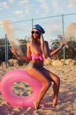 Sexy blond woman in bikini and aviator sunglasses — Stock Photo