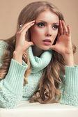 Beautiful blond woman in warm sweater — Stock Photo