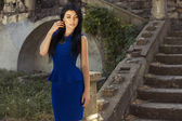 Beautiful girl with dark hair in elegant blue dress — Stock Photo