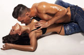 Sexy beautiful couple in jeans — Stock Photo