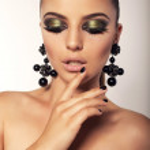 Постер, плакат: Beautiful girl with smokey eyes makeup and bijou