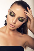 Beautiful girl with smokey eyes makeup and bijou — Stock Photo