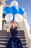 Beautiful elegant girl with dark hair with baloons — Stock Photo