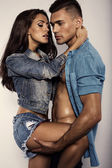 Sexy beautiful couple in jeans clothes — Stock Photo