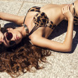 Sexy beautiful woman with long curly hair in luxurious bikini — Stock Photo #49335159