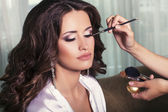Bride's preparation.making make up before wedding — Stock Photo