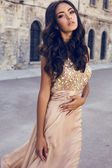 Beautiful girl with dark hair  in luxurious dress  — Stock Photo