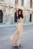 Beautiful girl with dark hair  in luxurious silk dress  — Stock Photo