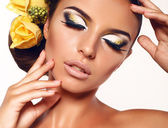Portrait of beautiful girl with extravagant makeup — Stock Photo