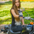 Young girl a motorbike — Stock Photo #39313001