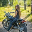 Young girl a motorbike — Stock Photo #39318149