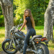 Young girl a motorbike — Stock Photo