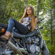 Young girl a motorbike — Stock Photo #39328799