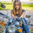 Girl a motorbike — Stock Photo #39332455