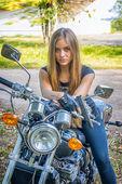 Girl a motorbike — Stock Photo
