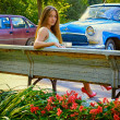 Girl on a background of retro car — Stock Photo