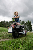 Girl on a motorcycle — Stock Photo