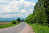 Road for hitchhiker — Stock Photo