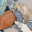 Woman bust with fine bonnet and fan — Stock Photo