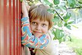 The small girl hiding — Stock fotografie