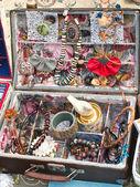 A suitcase full of handmade jewellery — Stock Photo