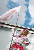 Small girl in vyshyvanka with a flag — Stock Photo