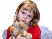 Small girl with dog toy — Stock Photo