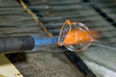 Closeup of a flame and melting glass piece — Stock Photo