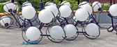 White globes of street lamps — Stock Photo