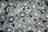 Pile of glass silvered half-finished dusty balls — Stock Photo