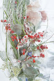Frozen vivid bouquet with berries inside the ice block — Stock Photo