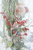 Frozen vivid bouquet with berries inside the ice block — Stock Photo