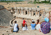 Tourists visit the ancient theater in Turkey — Stock Photo