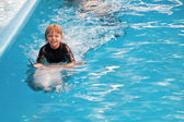 Riding on a dolphin 3 — Stock Photo