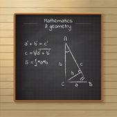 School chalkboard on the wooden background — Vecteur