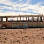Abandoned bus in the desert — Stock Photo #38359281
