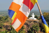 Buddhist flag and Buddha, Mihintale, Sri Lanka — Stock Photo