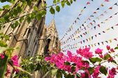 Mysore gothic Cathedral with colorful prayer flags — Stock Photo