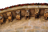 Corbels. San Pedro de Cervatos. Cantabria. Spain. — Stock Photo