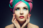 Beautiful lady with colored turban — Stock Photo