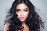 Young and beautiful asian woman with curly hair — Stock Photo